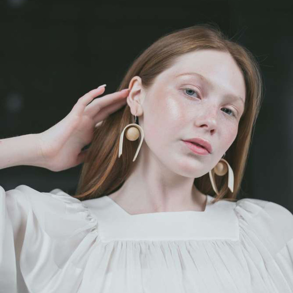 Model wearing Sustainable BirchWood Wooden Bent Designer Drop Earrings on IndieFaves