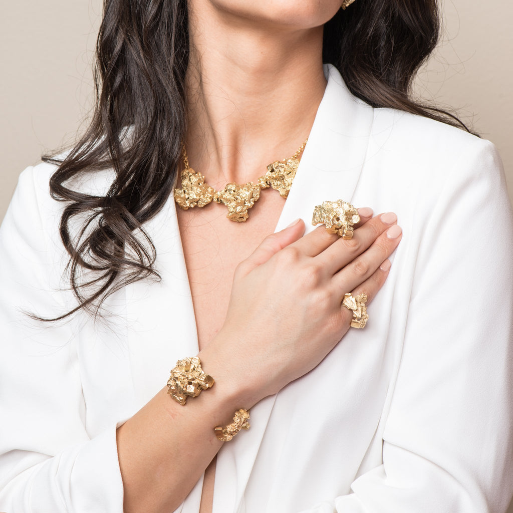 Model in white showing off the 18K Gold-Plated Brass Fluorita Big Designer Bracelet on IndieFaves