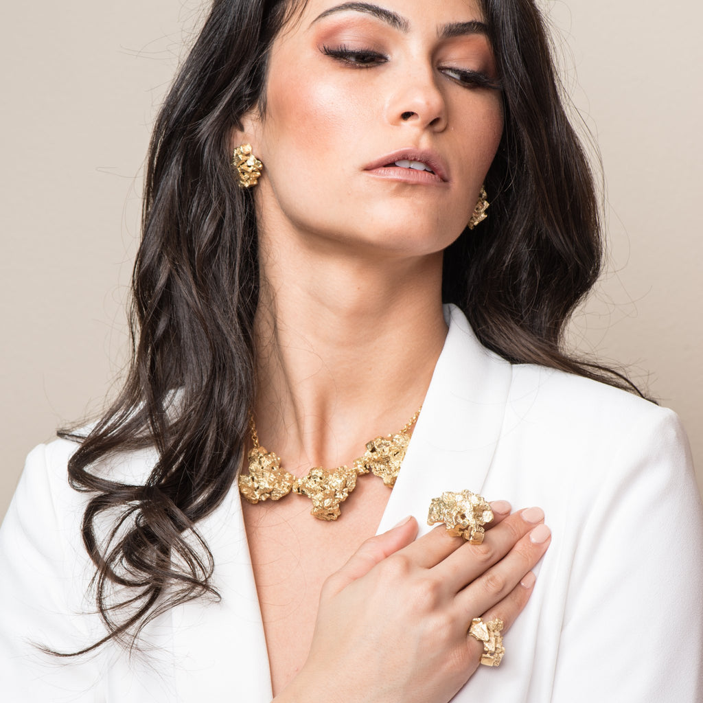 Model in gold jewelry showing off the 18K Gold-Plated Brass Designer Necklace on IndieFaves