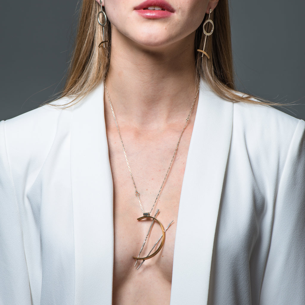 Model in white jacket wearing Sterling Silver Half Circle Designer Necklace on IndieFaves