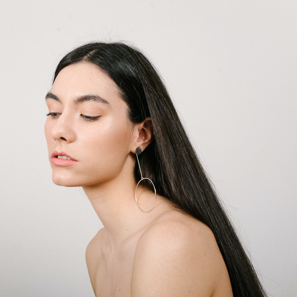 Model wearing Monom Studio - Sterling Silver Oversized Circle Designer Earrings on IndieFaves