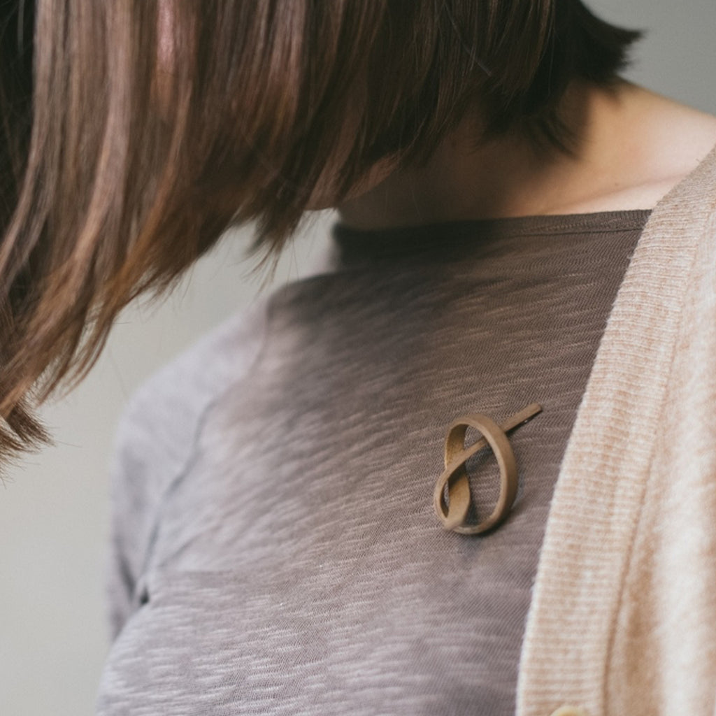 Model wearing Sustainable Walnut Wooden Alpha Designer Brooch on IndieFaves