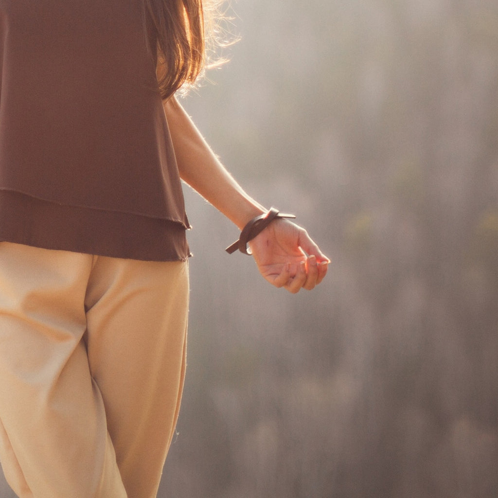 Model wearing Sustainable Walnut Wooden X Designer Bracelet on IndieFaves