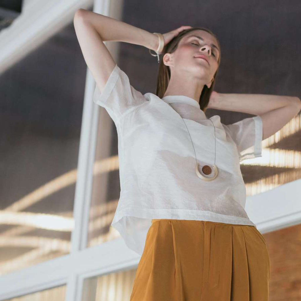 Model wearing Sustainable BirchWood Wooden Light and Dark Designer Necklace with Chain on IndieFaves