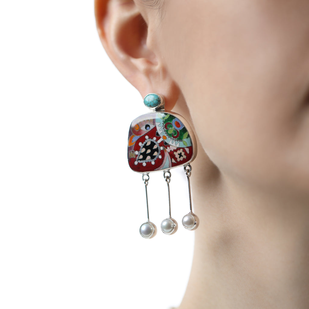 Model wearing White Pearl and Silver Nature Fusion Designer Earrings on IndieFaves
