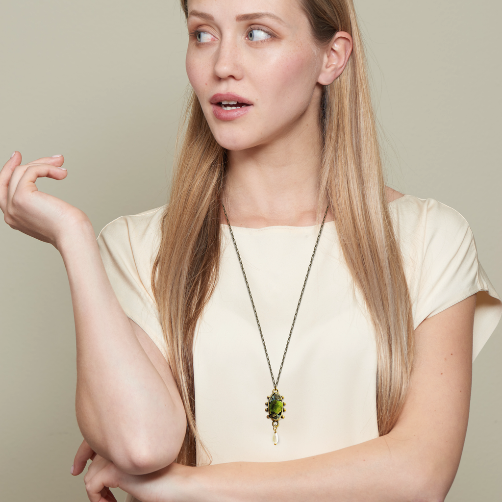 Model wearing Pauletta Brooks - Green Tourmaline Designer Pendant With Pearl on IndieFaves