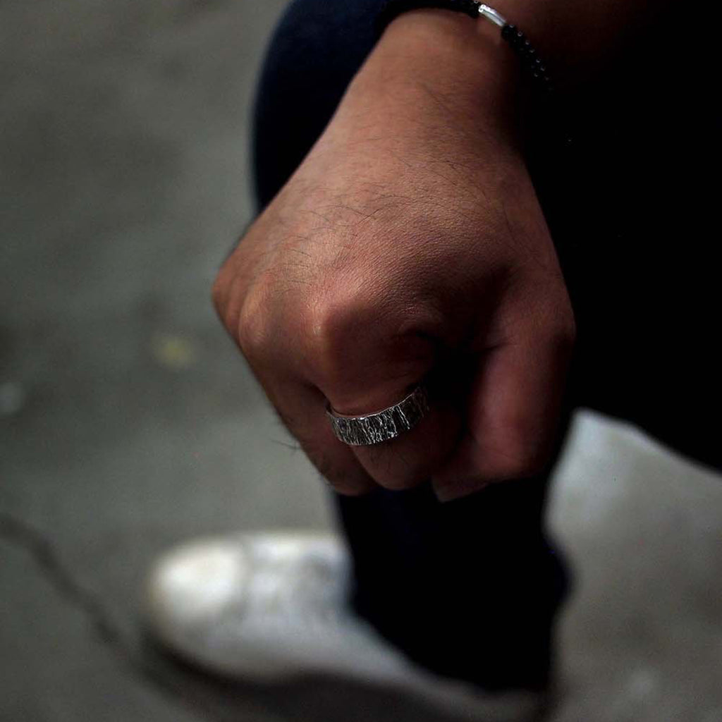 Model wearing Men's Oxidized Sterling Silver Husk 8 Designer Ring on IndieFaves