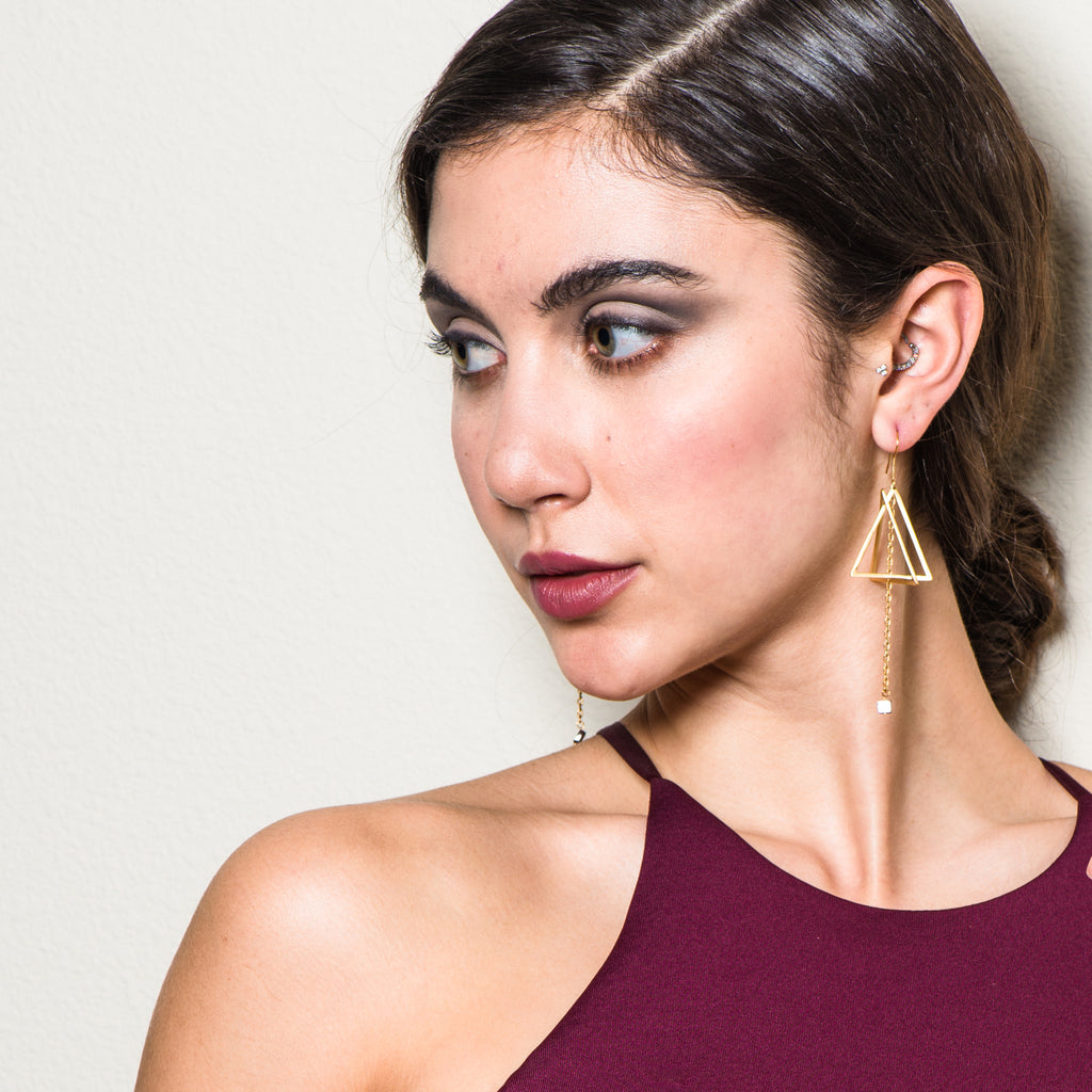 Model wearing 18K Gold-Plated and Garnet Double Triangle Dangle Designer Earrings on IndieFaves
