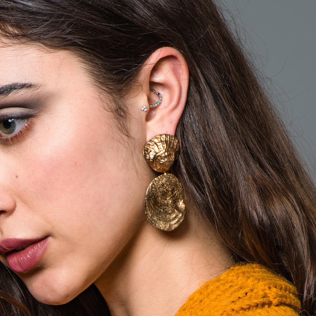 Model wearing Bronze Shell Dangle Designer Earrings on IndieFaves
