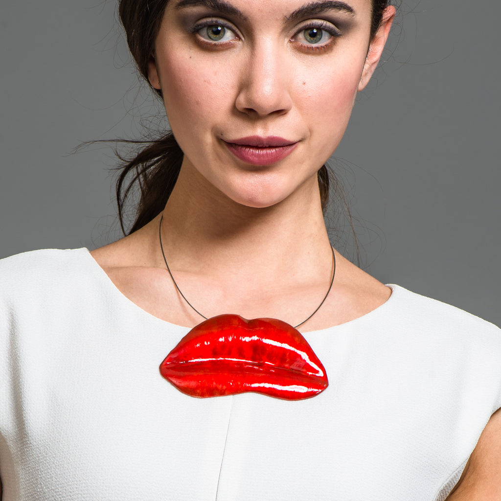 Model wearing Red Enamel Bronze Lips Designer Necklace on IndieFaves