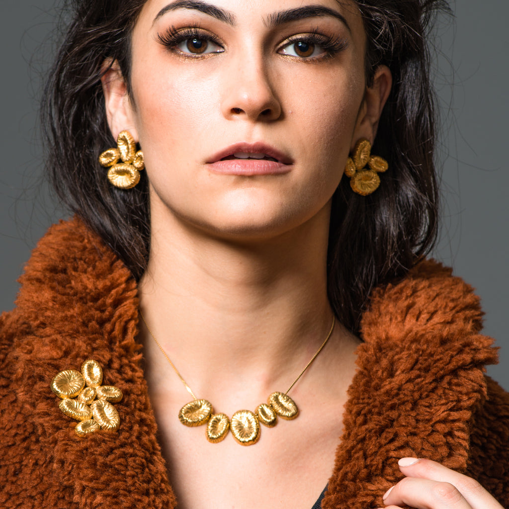 Model in a formal coat wearing 18K Gold-Plated Silver Loose Designer Necklace on IndieFaves