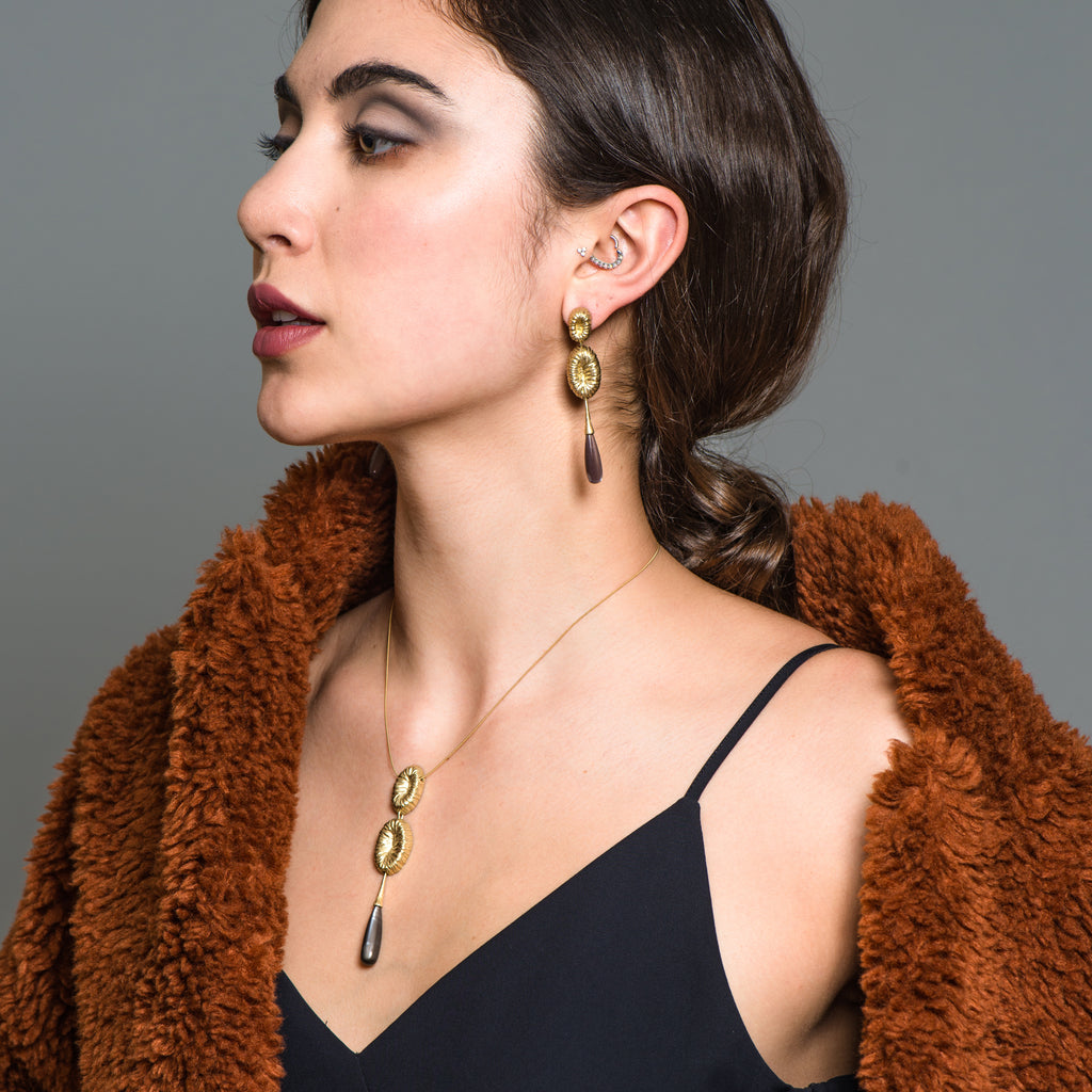 Model in black gown wearing the 18K Gold-Plated Silver and Green Opal Drop Designer Earrings on IndieFaves