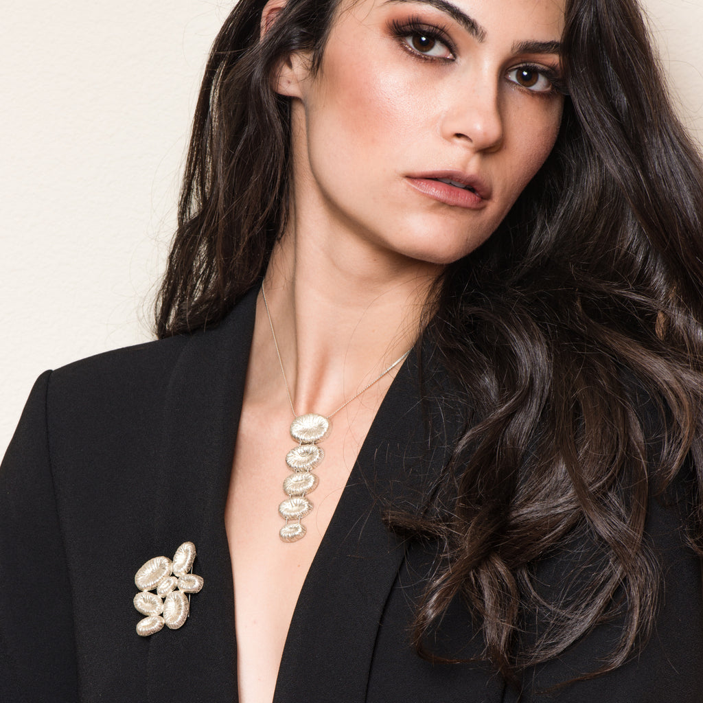 Model in black blazer wearing the Silver Stairs Designer Necklace on IndieFaves