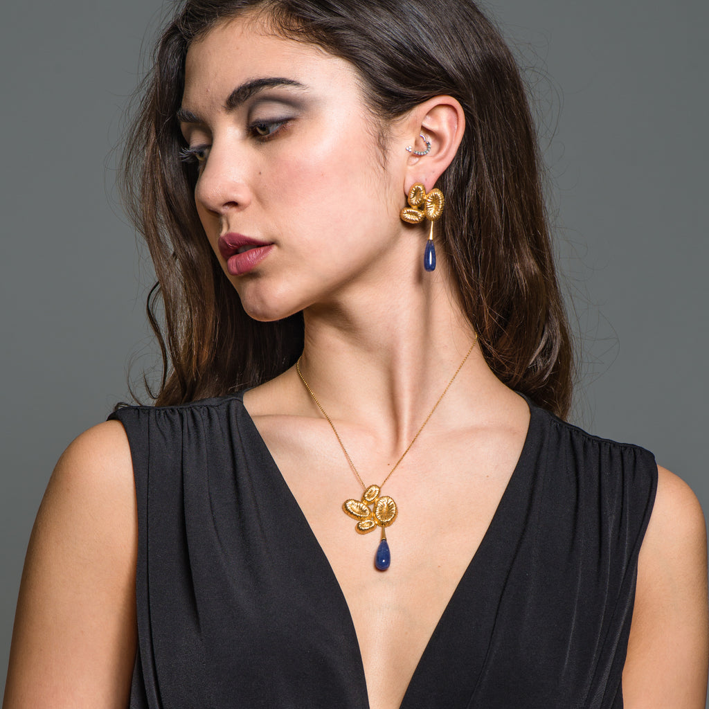 Model wearing 18K Gold-Plated Silver Dangle Designer Earrings with Tanzanite Drops on IndieFaves