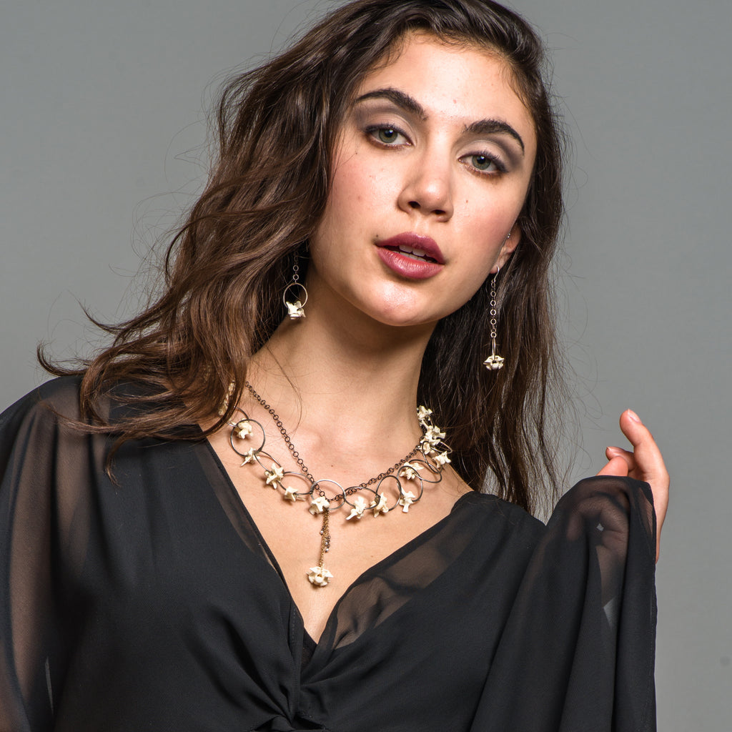 Model wearing Susan Drews Watkins - Python Vertebrae Designer Earrings on IndieFaves
