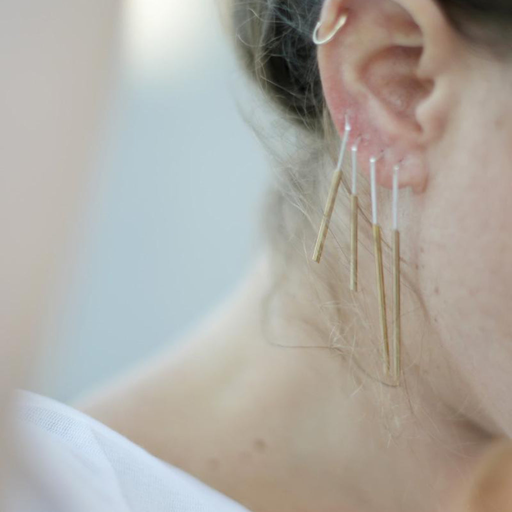 Model wearing Tami Eshed - Double Line Gold and Silver Designer Earrings on IndieFaves