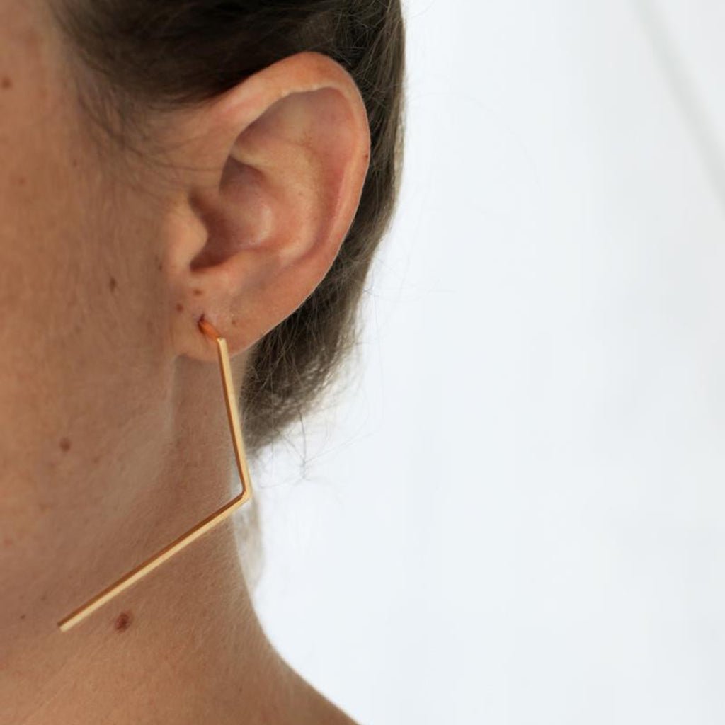 Model wearing Tami Eshed - V-Shaped Black Designer Earrings on IndieFaves
