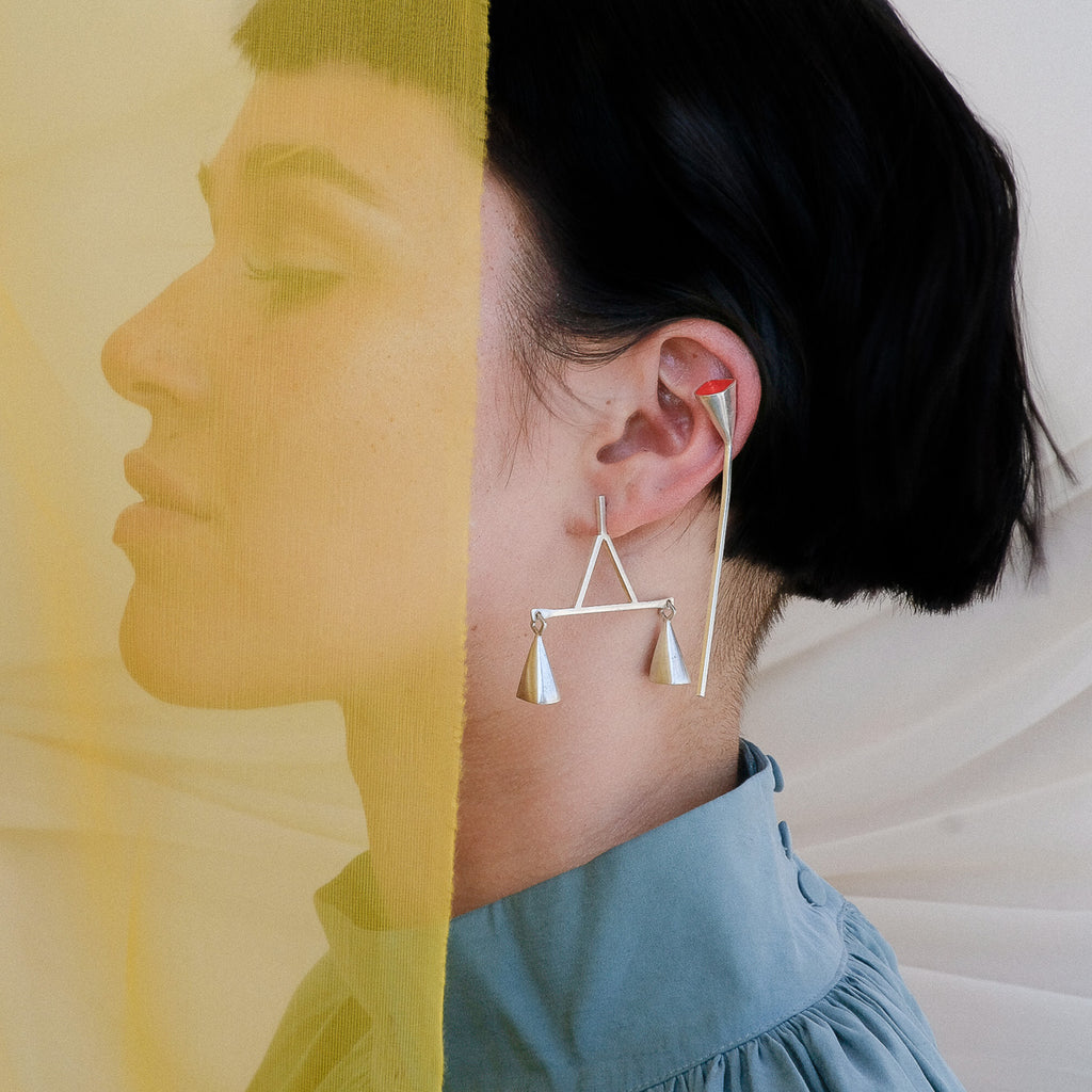 Model wearing Anja Berg - Silver and Red Enamel Red Line Designer Earrings on IndieFaves
