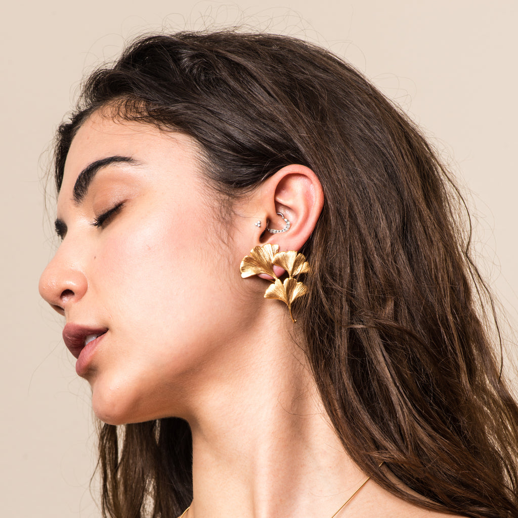 Model wearing Gingko Designer Earrings on IndieFaves