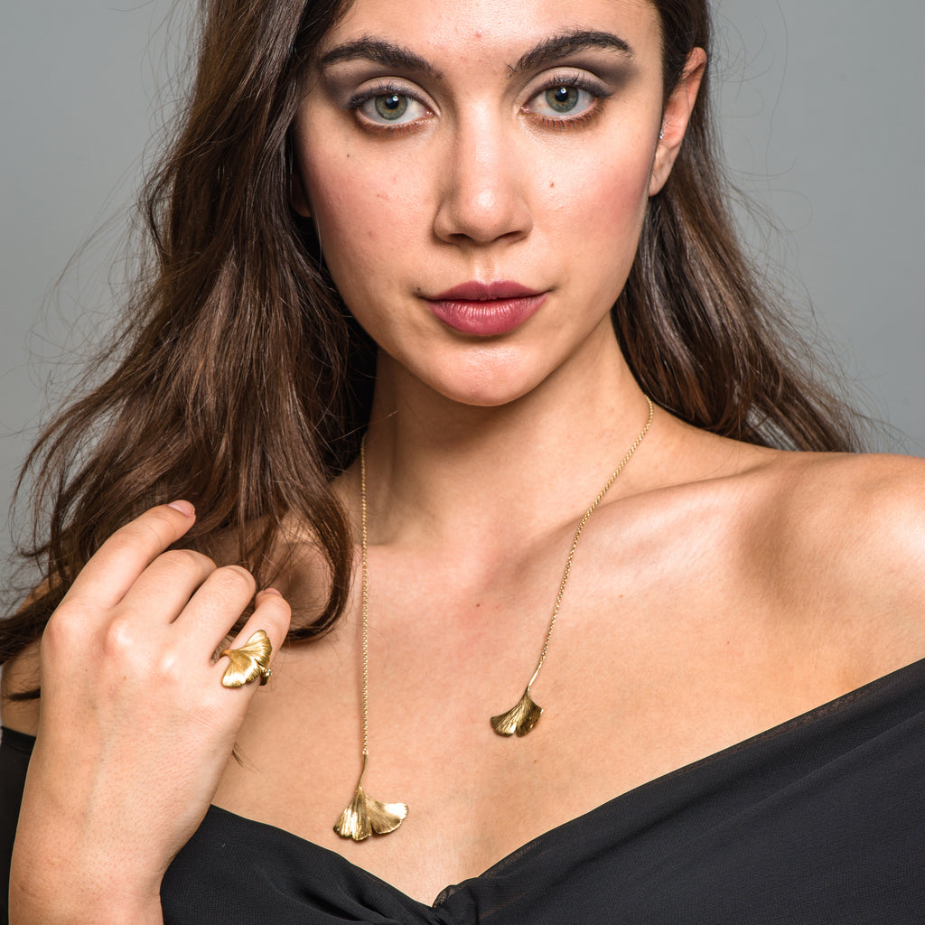 Model wearing Mara Soriano - Gingko Designer Necklace with Green Sapphire on IndieFaves