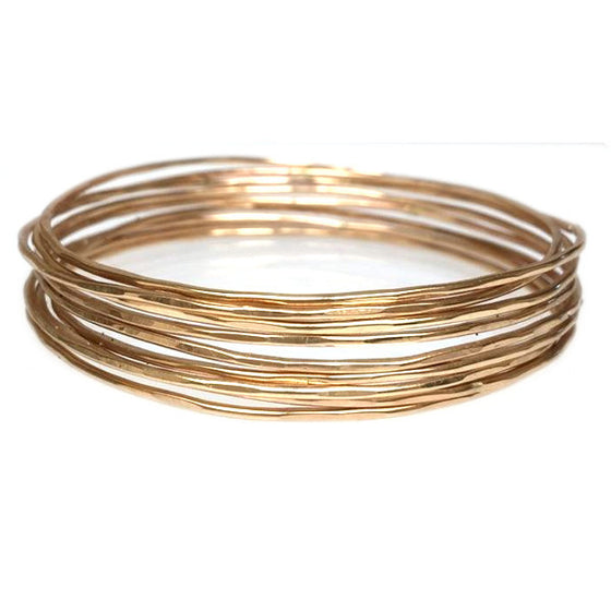 stacking and of karma textured gold set silver bangles hammered
