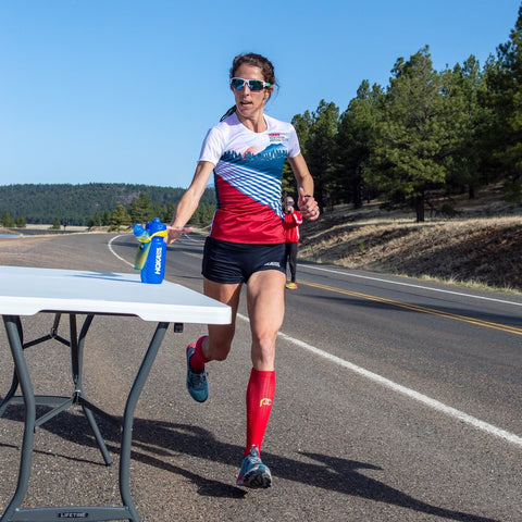 Half Marathon Training Plan for Beginners Steph Bruce water bottle aid station