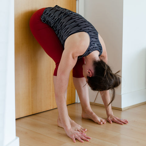 Jasyoga stretches for runners forward fold at wall