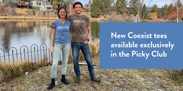 Founders Lauren and Jesse in new Coexist shirts in blue and brown