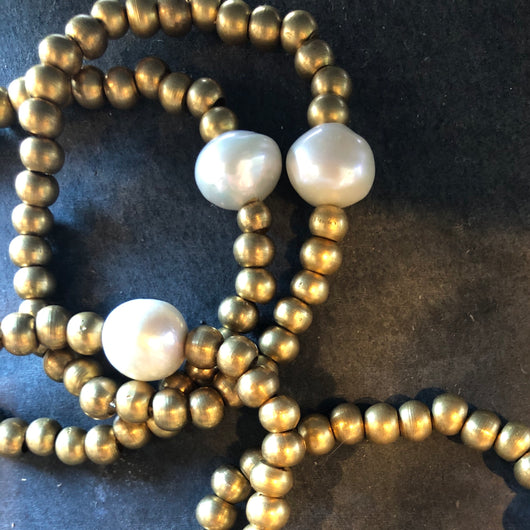 Brass with large pearl