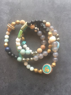 multi bead, multi strand bracelet with ohm charm, african brass beads, semi precious stones