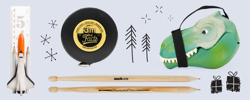 Gift guide for kids with space stationery, drumstick pencils, tape measure and dinosaur carry case,