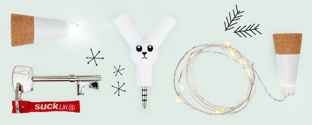 Gift guide for office secret santa, including bottle light, key bottle opener, and jack rabbit earphone splitter.