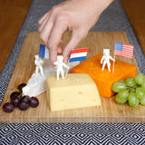 Suck UK Astronaut Food Flags planted into blocks of cheese with grapes at a dinner party.