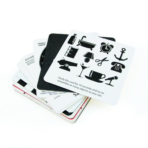 Beer mats in a pile displaying games on a white background