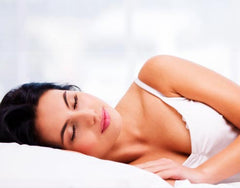 Sleeping woman with UltraBlock mattress protector