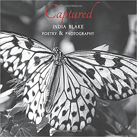 Captured - By India Blake - Paperback