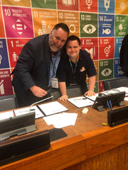 John and Mark signing an agreement on the SDGs