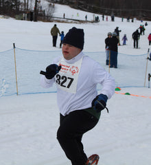 John running hard in Special Olympic Snowshoe