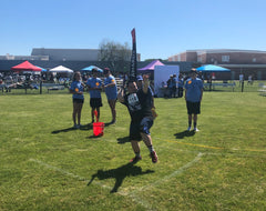 John throws the javelin in the Special Olympics