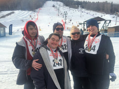 John with Special Olympics snowshoe team