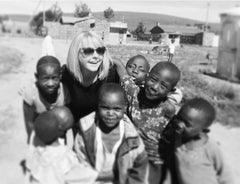 Social Enterprise Essence of Humanity's Cassandra Treadwell with children in Africa