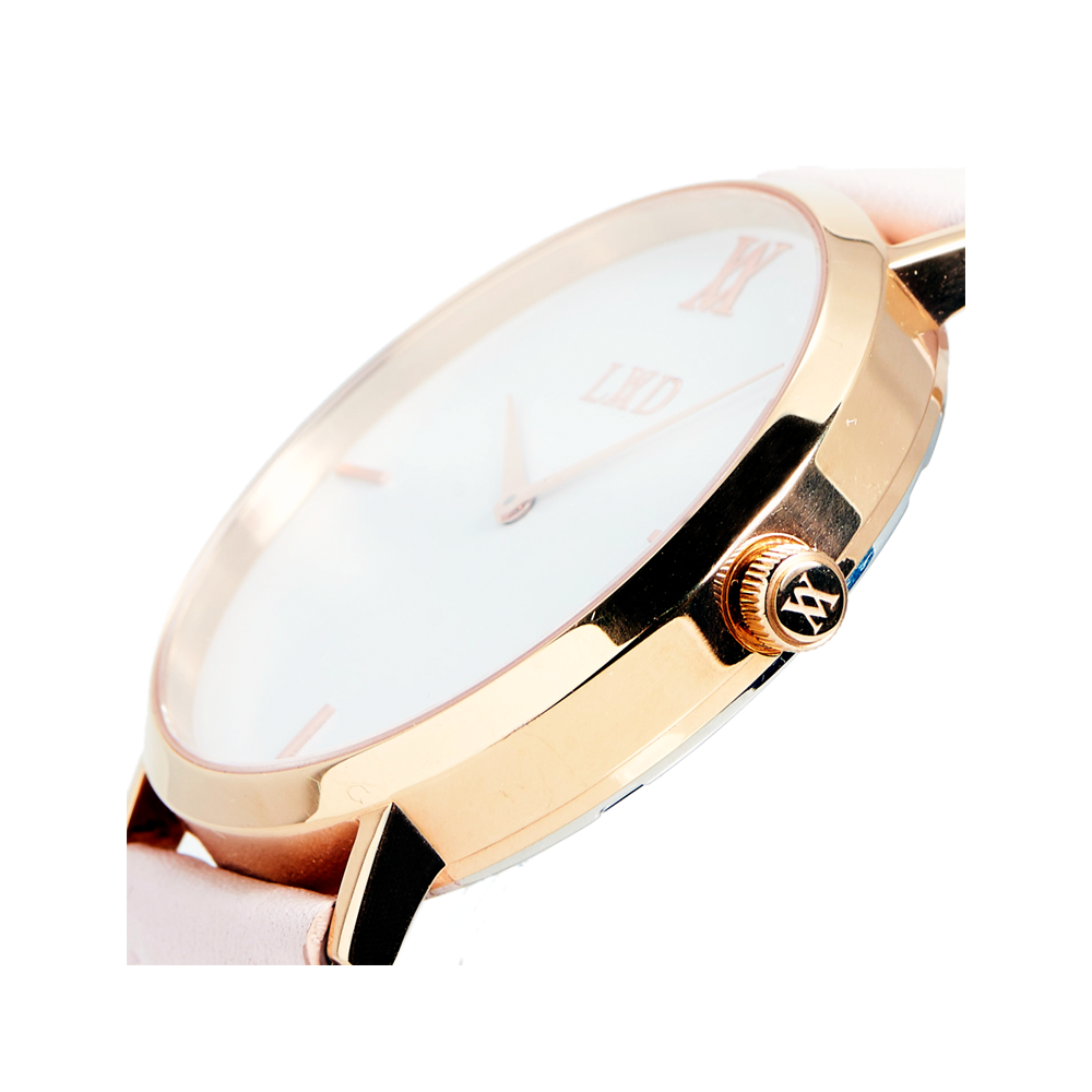 rose gold case with black dial minimalist unisex watch with nude pink strap with monogram side crown logo engraving