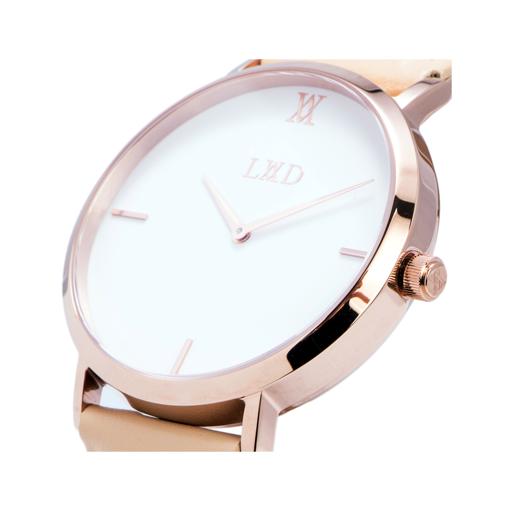 Minimal rose gold watch with white dial and tan leather strap and monogram
