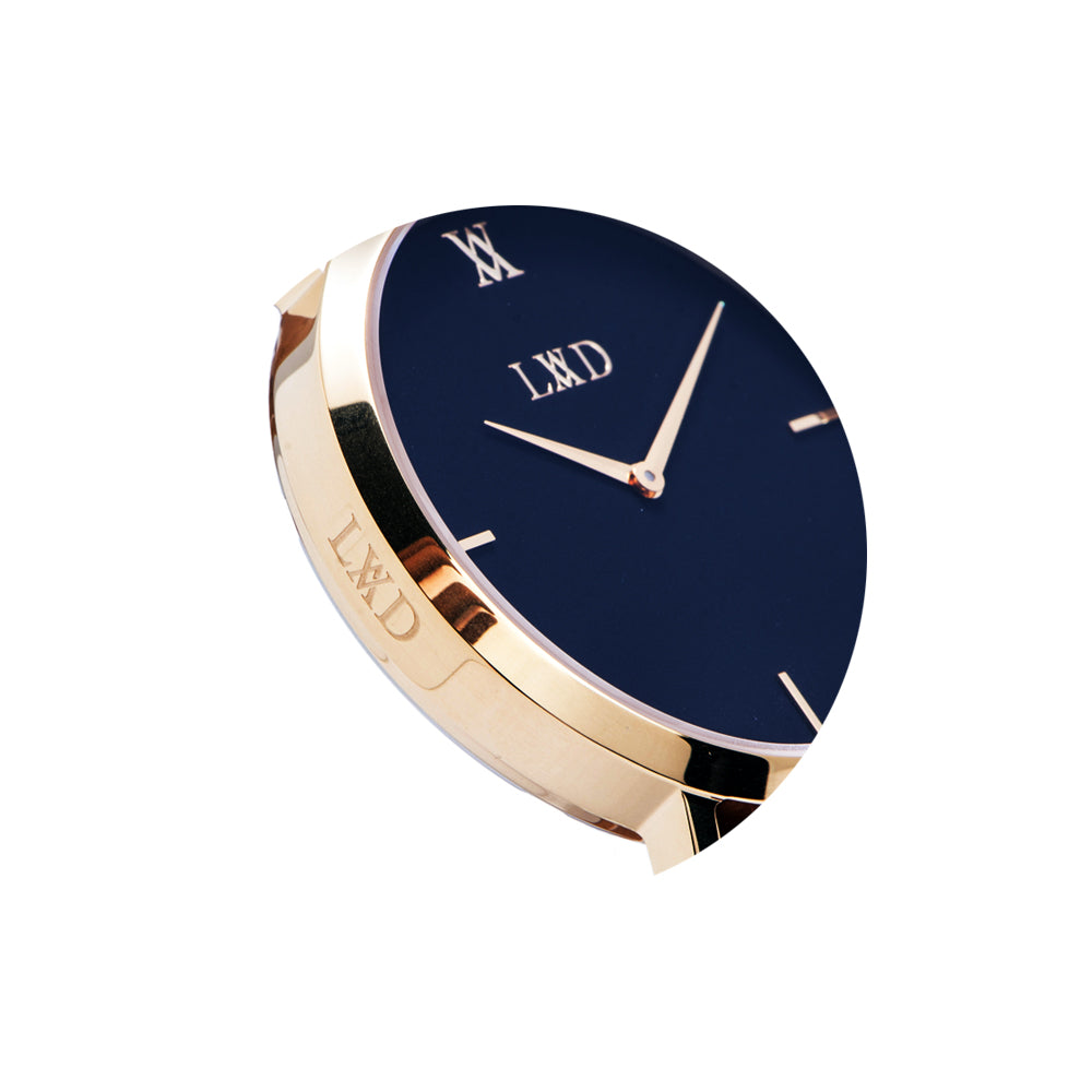gold minimalist watch with black dial closeup