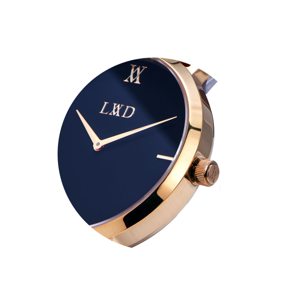 gold minimalist watch with black dial closeup crown