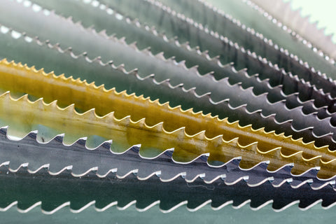 close-up photo of a multitude of different saw blade teeth