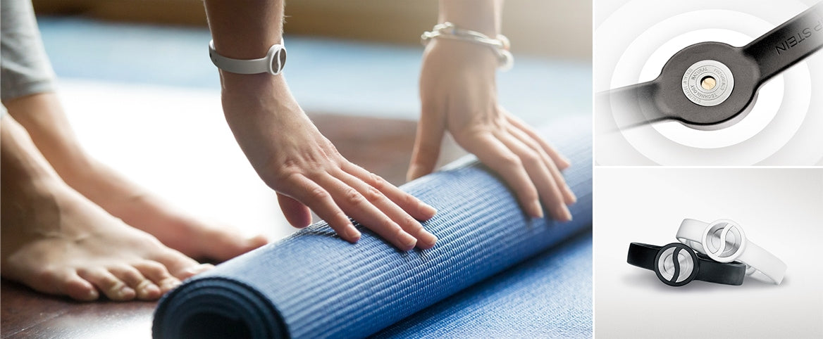Woman unrolling a yoga mat while wearing a sport bracelet. The back of a sport bracelet. The black and white sport bracelets.