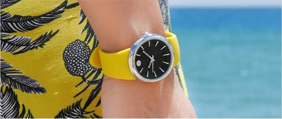 Woman wearing a natural frequency watch with a yellow strap