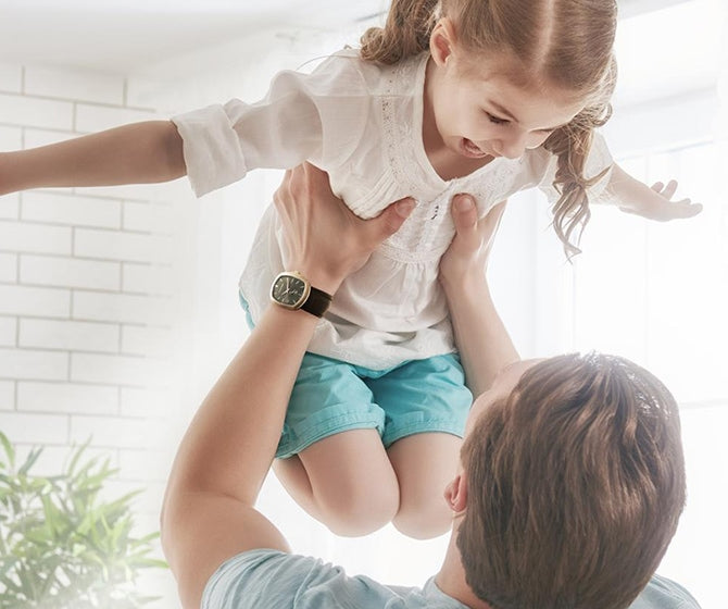 Man lifting his daughter in the air