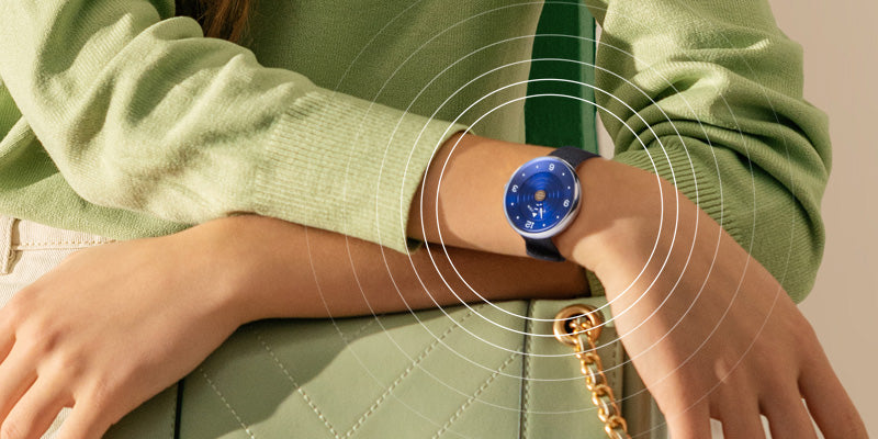 Woman wearing a Philip Stein Natural Frequency Technology watch